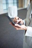 Businesswoman using a personal digital assistant