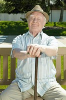 Senior man sitting on outdoor bench