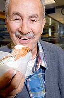 Man eating cannoli