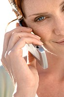 Portrait of a mid adult woman talking on a mobile phone