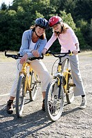 Mother and daughter on bikes