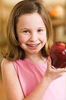 Girl holding red apple