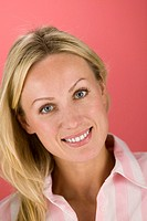 Smiling woman tilting head to side