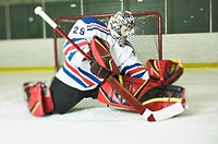 Ice hockey goalie in defensive pose