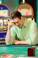 Man losing at gambling table