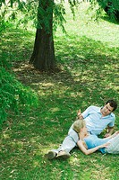 Couple reclining on grass