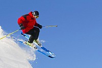 Skier jumping off in mid-air