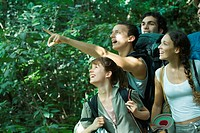 Group of hikers, one pointing to distance