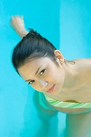Young woman in pool, high angle view