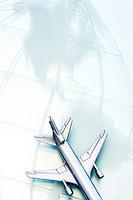 Toy aeroplane on map, close-up