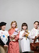Girls 5-9 dressed as artist, mother, veterinarian and businesswoman