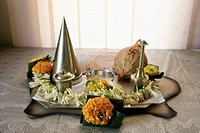 pooja puja thali , on all good Occasion and birthday in the family this is prepared which has ´kunkoo´ for tilak rice coconut sugar gulabjal and garla...