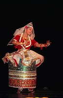woman performing indian classical manipuri dance , india , MR