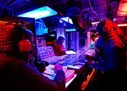 ARABIAN SEA (April 9, 2007) - Sailors manning Flight Deck Control relay messages throughout the ship about the status of the flight deck during a gene...