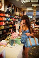 Young woman shopping for perfume