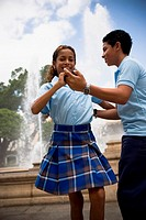 School children dancing salsa in center plaza