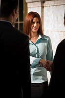 Businesswoman interacting with businessman