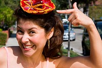 Young woman wearing tiny Mexican sombrero
