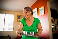 Mature woman holding a tray and smiling