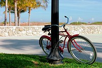 Bicycle parked against a pole