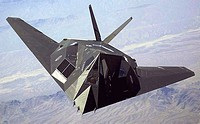 An F-117 Nighthawk flies over the Nevada desert. The unique design of the single-seat F-117 provides exceptional combat capabilities. The fighter can ...