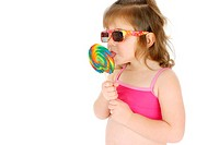 Girl with sunglasses eating lollipop