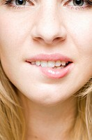 Teenage girl biting her lip (thumbnail)