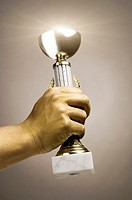 Golden hand holding trophy