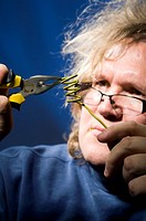 Man shaping cable with plier
