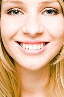 Close-up of teenage girl smiling