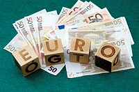 Banknotes and blocks spelling 'Euro'
