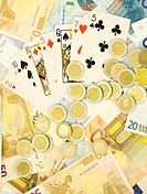 Euro banknotes, coins and playing cards