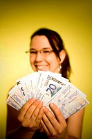 Happy woman showing banknotes in her hands