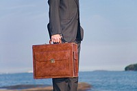 Close-up on businessman carrying a briefcase