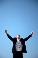 Businessman with arms wide open