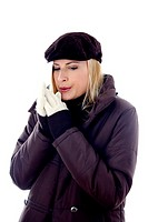 Woman in winter clothing warming up her hands