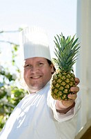 Chef holding a pineapple