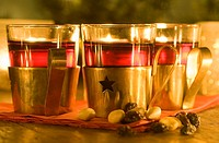 Mulled wine in glasses with decorative holder