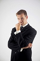 Businessman contemplating and looking at camera (thumbnail)