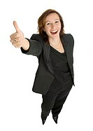 Businesswoman showing thumbs up and posing for the camera