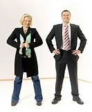 Businessman standing beside a funnily dressed businesswoman