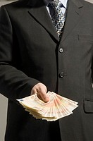 Businessman offering money