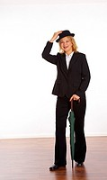 Businesswoman posing with a green umbrella and a hat