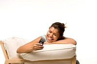 Woman smiling while text messaging on the mobile phone