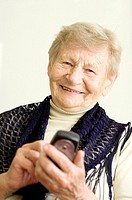 Senior woman text messaging on the mobile phone
