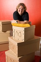 Man posing on stacked boxes