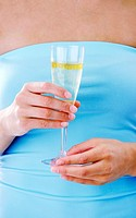 Woman holding a glass of champagne (thumbnail)