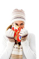 Woman in winter clothing holding a gift