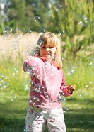 Girl playing with soap bubbles (thumbnail)
