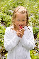 Girl posing with strawberry (thumbnail)
